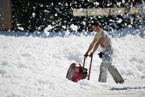 Snow removal specialist doing the hard work