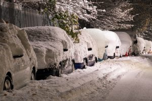 Cars buried in Michigan snow